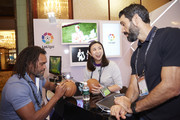 VIP Guests Christian Karembeu, Shen Yanfei and Ferando Sanz signing balls at the Laliga booth at the Sportel Asia Conference on March 15, 2016 in Singapore.