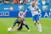 Marco Di Vaio #9 of the Montreal Impact controls the ball against Michael Harrington #2 of the Sporting KC during the MLS match at Saputo Stadium on September 22, 2012 in Montreal, Quebec, Canada.