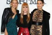 Teen Vogue Editor-In-Chief Amy Astley (C) poses for a photo with models Gigi Hadid (L) and Bella Hadid (R) at Sportmax and Teen Vogue Celebrate The Fall/Winter 2014 Collection at Sportmax on October 28, 2014 in New York City.