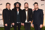Matthew, Nathan, Caleb, and Jared Followill of Kings of Leon attend the Sports Illustrated 2015 Swimsuit Takes Over The Schermerhorn Symphony Center event on February 11, 2015 in Nashville, Tennessee.