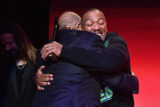 Quincy Jones (L) and Timbaland embrace onstage during Spotify's Secret Genius Awards Hosted By NE-YO at The Theatre at Ace Hotel on November 16, 2018 in Los Angeles, California.