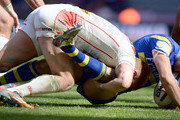 Josh Jones (L) of  St Helens taclkles Stefan Ratchford  of  Warrington Wolves during the Super League match between St Helens and  Warrington Wolves at St James' Park on May 31, 2015 in Newcastle upon Tyne, England.