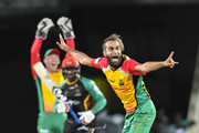 In this handout image provided by CPL T20, Imran Tahir (R) of Guyana Amazon Warriors appeals for ruling against Devon Thomas (C) of St Kitts & Nevis Patriots during match 19 of the Hero Caribbean Premier League between St Kitts & Nevis Patriots and Guyana Amazon Warriors at the Warner Park Sporting Complex on August 25, 2018 in Basseterre, St Kitts, Saint Kitts And Nevis.