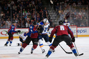 T.J. Oshie #74 of the St. Louis Blues controls the puck against Matt Duchene #9 and Jan Hejda #8 of the Colorado Avalanche at Pepsi Center on December 13, 2014 in Denver, Colorado. The Blues defeated the Avalanche 3-2 in overtime.