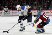 Colton Parayko #55 of the St Louis Blues advances the puck against Blake Comeau #14 of the Colorado Avalanche at the Pepsi Center on April 7, 2018 in Denver, Colorado.