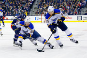 Vince Dunn #29 of the St. Louis Blues and Colton Parayko #55 of the St. Louis Blues work to keep the puck away from Thomas Vanek #26 of the Columbus Blue Jackets during the second period on March 24, 2018 at Nationwide Arena in Columbus, Ohio.