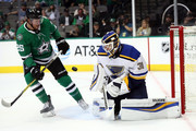 Chad Johnson #31 of the St. Louis Blues makes  a save in front of Brett Ritchie #25 of the Dallas Stars in the first period during a preseason game at American Airlines Center on September 18, 2018 in Dallas, Texas.