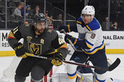 Pierre-Edouard Bellemare #41 of the Vegas Golden Knights and Scottie Upshall #9 of the St. Louis Blues go after a loose puck in the second period of their game at T-Mobile Arena on March 30, 2018 in Las Vegas, Nevada. The Golden Knights won 4-3 in overtime.