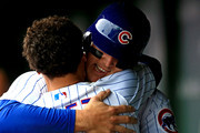 Anthony Rizzo #44 of the Chicago Cubs celebrates with Javier Baez #9 in the dugout after scoring a run in the third inning against the St. Louis Cardinals at Wrigley Field on September 30, 2018 in Chicago, Illinois.