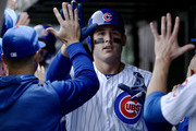 Anthony Rizzo #44 of the Chicago Cubs celebrates with teammates in the dugout after hitting a three run home run in the third inning against the St. Louis Cardinals at Wrigley Field on May 03, 2019 in Chicago, Illinois.