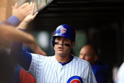 Anthony Rizzo #44 of the Chicago Cubs celebrates with teammates in the dugout after scoring a run in the third inning against the St. Louis Cardinals at Wrigley Field on September 30, 2018 in Chicago, Illinois.