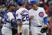 Willson Contreras #40, Anthony Rizzo #44 and Kyle Hendricks #28 of the Chicago Cubs celebrate the 4-0 win against the St. Louis Cardinals at Wrigley Field on May 03, 2019 in Chicago, Illinois.