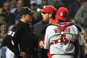 (L-R) Home plate umpire Pat Hoberg #31 Mike Matheny #26 of the St. Louis Cardinals and Yadier Molina #4 argue during the sixth inning on July 8, 2015 at Wrigley Field in Chicago, Illinois.