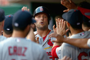 Matt Holliday #7 of the St. Louis Cardinals celebrates with teammates after scoring a run in the first inning during the game against the Cincinnati Reds at Great American Ball Park on September 10, 2014 in Cincinnati, Ohio.