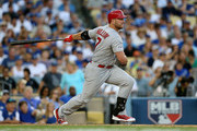 Matt Holliday #7 of the St. Louis Cardinals hits a single in the seventh inning against the Los Angeles Dodgers during Game One of the National League Division Series at Dodger Stadium on October 3, 2014 in Los Angeles, California.
