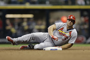 Matt Holliday #7 of the St. Louis Cardinals slides into second base with a double in the top of the fourth inning against the Milwaukee Brewers at Miller Park on July 11, 2014 in Milwaukee, Wisconsin.