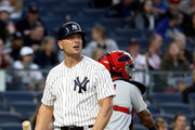Matt Holliday #17 of the New York Yankees walks to the dugout after he struck out in the first inning against the St. Louis Cardinals on April 14, 2017 at Yankee Stadium in the Bronx borough of New York City.