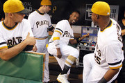 Andrew McCutchen #22 of the Pittsburgh Pirates jokes around with teammates Gregory Polanco #25, Neil Walker #18 and Gorkys Hernandez #51 before the game against the St. Louis Cardinals at PNC Park on July 12, 2015 in Pittsburgh, Pennsylvania.
