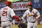 Matt Holliday #7 of the St. Louis Cardinals celebrates his solo home run with Allen Craig #21 of the St. Louis Cardinals during the sixth inning of a game against the Tampa Bay Rays on June 10, 2014 at Tropicana Field in St. Petersburg, Florida.