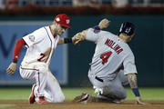 Yadier Molina #4 of the St. Louis Cardinals is caught stealing second base by Trea Turner #7 of the Washington Nationals in the eighth inning at Nationals Park on September 5, 2018 in Washington, DC.