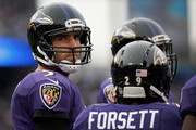 Quarterback  Joe Flacco #5 of the Baltimore Ravens stands next to Justin Forsett #29 during the first half against the St. Louis Rams at M&T Bank Stadium on November 22, 2015 in Baltimore, Maryland.