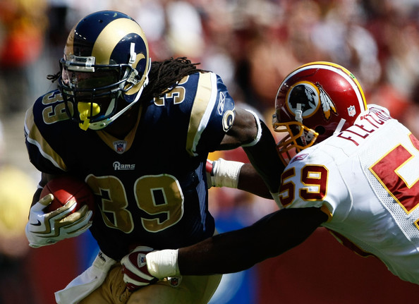 Steven Jackson #39 of the St. Louis Rams is tackled by London Fletcher #59 of the Washington Redskins during their game on September 20, 2009 at FedEx Field in Landover, Maryland. The Redskins defeated the Rams by a score of 9-7. (September 19, 2009 - Photo by Win McNamee/Getty Images North America)