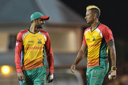 In this handout image provided by CPL T20, Shoaib Malik (L) and Rayad Emrit (R) of Guyana Amazon Warriors during match 15 of the Hero Caribbean Premier League between St Lucia Stars and Guyana Amazon Warriors at the Darren Sammy Cricket Ground on August 24, 2018 in Gros Islet, Saint Lucia.
