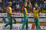 In this handout image provided by CPL T20, Rayad Emrit (L), Imran Tahir (C) and Veerasammy Permaul (R) of Guyana Amazon Warriors celebrats the dismissal of David Warner of St Lucia Stars during match 15 of the Hero Caribbean Premier League between St Lucia Stars and Guyana Amazon Warriors at the Darren Sammy Cricket Ground on August 24, 2018 in Gros Islet, Saint Lucia.