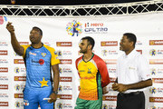 In this handout image provided by CPL T20, Kieron Pollard (L) of St Lucia Stars toss the coin as Shoaib Malik (C) of Guyana Amazon Warriors and match referee Denavon Hayles (R) looks on during match 15 of the Hero Caribbean Premier League between St Lucia Stars and Guyana Amazon Warriors at the Darren Sammy Cricket Ground on August 24, 2018 in Gros Islet, Saint Lucia.