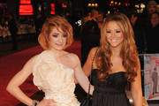Nicola Roberts and Kimberley Walsh from Girls Aloud attend the World premiere of 'St Trinian's 2: The Legend of Fritton's Gold' at the Empire Leicester Square on December 9, 2009 in London, England.