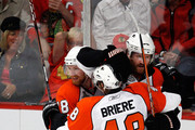 Danny Briere #48 of the Philadelphia Flyers celebrates with Claude Giroux #28 and Scott Hartnell #19 after scoring a goal in the first period againstthe Chicago Blackhawks in Game One of the 2010 NHL Stanley Cup Final at the United Center on May 29, 2010 in Chicago, Illinois.