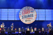 """Jon Pardi and Ryan Hurd perform on stage during """"Stars and Strings Presented by RAM Trucks Built to Serve,"""" a RADIO.COM Event, at the Fox Theatre on November 06, 2019 in Detroit, Michigan."""