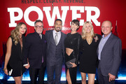 """(L-R) A guest, Mark Canton, Omari Hardwick, Jennifer Pfautch, Tina Trahan and STARZ CEO Chris Albrecht attend the Starz """"Power"""" The Fifth Season NYC Red Carpet Premiere Event & After Party on June 28, 2018 in New York City."""