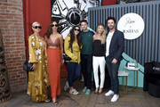 (L-R) Lala Kent, Kristen Doute, Kate Maloney, Tom Schwartz, Stassi Schroeder, and Beau Clark pose as Stassi Schroeder presents: Outfit Of The Day Collection exclusively on JustFab, on #NationalOOTDDay at Norah on June 25, 2019 in West Hollywood, California.