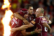 Greg Inglis (C) of the Maroons celebrates with Johnathan Thurston and Darren Lockyer after scoring a try during game one of the ARL State of Origin series between the New South Wales Blues and the Queensland Maroons at ANZ Stadium on May 26, 2010 in Sydney, Australia.