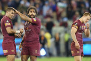 Justin Hodges (L) Sam Thaiday (C) and Daly Cherry-Evans of the Maroons react after their defeat during game two of the State of Origin series between the New South Wales Blues and the Queensland Maroons at the Melbourne Cricket Ground on June 17, 2015 in Melbourne, Australia.