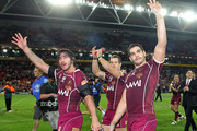 (L-R) Johnathan Thurston, Ashley Harrison and Greg Inglis of the Maroons wave to fans as they celebrate victory after game two of the ARL State of Origin Series between the New South Wales Blues and the Queensland Maroons at Suncorp Stadium on June 16, 2010 in Brisbane, Australia.