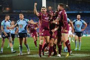 Johnathan Thurston (C) of the Maroons celebrates with Greg Inglis (L) after scoring the first try during game three of the ARL State of Origin series between the New South Wales Blues and the Queensland Maroons at ANZ Stadium on July 17, 2013 in Sydney, Australia.