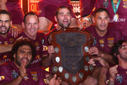 Greg Inglis, Sam Thaiday, Matthew Scott, Cameron Smith, Justin Hodges and Johnathan Thurston of the Maroons celebrate with the State of Origin shield as after victory after game three of the State of Origin series between the Queensland Maroons and the New South Wales Blues at Suncorp Stadium on July 8, 2015 in Brisbane, Australia.