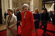Conservative MP and former prime minister Theresa May (C) processes with members of parliament through the Peers Lobby into the House of Lords to listen to the Queen's Speech during the State Opening of Parliament in the Houses of Parliament on October 14, 2019 in London, England. The Queen's speech is expected to announce plans to end the free movement of EU citizens to the UK after Brexit, new laws on crime, health and the environment.