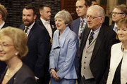 Former Prime Minister Theresa May walks with other Members of Parliament through the Commons Members Lobby to hear the state opening of parliament at the Houses of Parliament on December 19, 2019 in London, England. In the second Queen's speech in two months, Queen Elizabeth II will unveil the majority Conservative government's legislative programme to Members of Parliament and Peers in The House of Lords.