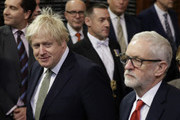Prime Minister, Boris Johnson and Leader of the Labour Party, Jeremy Corbyn arrive for the state opening of parliament at the Houses of Parliament on December 19, 2019 in London, England. In the second Queen's speech in two months, Queen Elizabeth II will unveil the majority Conservative government's legislative programme to Members of Parliament and Peers in The House of Lords.