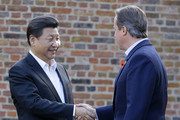 Retransmission of #493754626 with alternate crop.) British Prime Minister David Cameron welcomes Chinese President Xi Jinping to his official residence at Chequers on October 22, 2015 in Aylesbury, England. The President of the Peoples Republic of China, Mr Xi Jinping and his wife, Madame Peng Liyuan, end a State Visit to the United Kingdom as guests of The Queen.  They stayed at Buckingham Palace and undertook engagements in London and Manchester. The last state visit paid by a Chinese President to the UK was Hu Jintao in 2005.