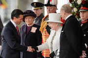 Queen Elizabeth II greets Mexican President Enrique Pena Nieto (2nd L) during a Ceremonial Welcome at Horse Guards Parade on March 3, 2015 in London, England.  The President of Mexico, accompanied by Senora Angelica Rivera de Pena, are on a State Visit to the United Kingdom as the guests of Her Majesty The Queen from Tuesday 3rd March to Thursday 5th March.