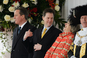 Home Secretary Theresa May (2nd R) laughs as she speaks with Prime Minister David Cameron (L) and Deputy Prime Minister Nick Clegg (2nd L) before the arrival of the President of Mexico, Enrique Pena Nieto and his wife Angelica Rivera at Horse Guards Parade on March 3, 2015 in London, England.  The President of Mexico, accompanied by Senora Angelica Rivera de Pena, are on a State Visit to the United Kingdom as the guests of Her Majesty The Queen from Tuesday 3rd March to Thursday 5th March.