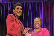Robin Roberts presents an award to Pamela El at the New York Gala benefiting The Steve Harvey Foundation at Cipriani, Wall Street on May 3, 2010 in New York City.