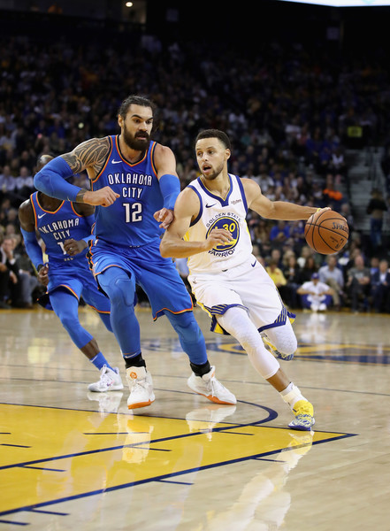 Oklahoma City Thunder vs. Golden State Warriors [photograph,player,basketball moves,basketball court,sports,basketball player,tournament,sport venue,team sport,ball game,basketball,stephen curry,user,user,note,terms,oracle arena,oakland,golden state warriors,oklahoma city thunder]