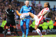 Paul Lambert, Manager of Stoke City looks on as Glen Johnson of Stoke City controls the ball during the Premier League match between Stoke City and Crystal Palace at Bet365 Stadium on May 5, 2018 in Stoke on Trent, England.