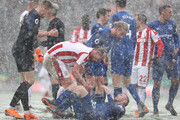 Charlie Adam of Stoke City checks if Wayne Rooney of Everton is ok during the Premier League match between Stoke City and Everton at Bet365 Stadium on March 17, 2018 in Stoke on Trent, England.
