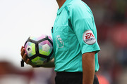 Referee Mike Dean holds the match ball during the Premier League match between Stoke City and Manchester City at the Britannia Stadium on August 20, 2016 in Stoke on Trent, England.
